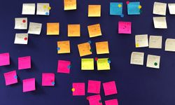 A wall of Post-It sketches after a session